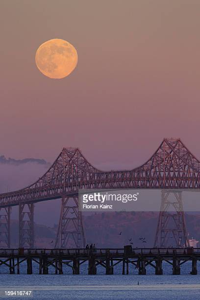 August 1, 2012 - the full Moon rises to the east of the Richmond San Rafael Bridge. The bridge, which crosses the San Francisco Bay in California, is...