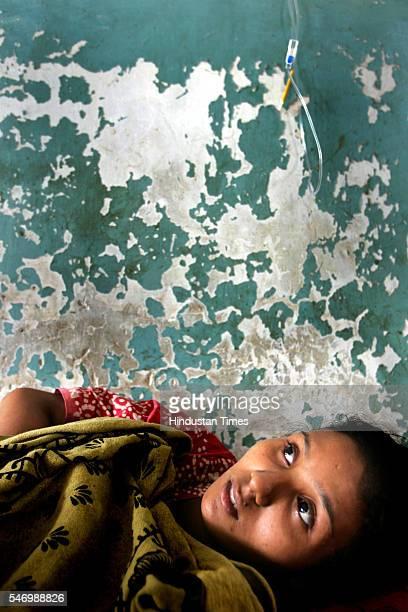 August 10, 2005: Rekha Goswami from Juhu Koliwada, taking treatment for high fever at Bhabha hospital.