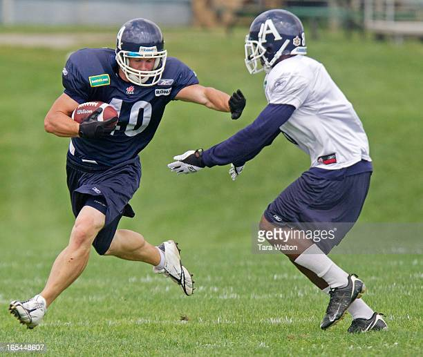 August 10 2010ARGOS PRACTICEBryan Crawford carries the ball past teammate Joshua Abrams during practice Tuesday August 10 2010 at the Toronto...