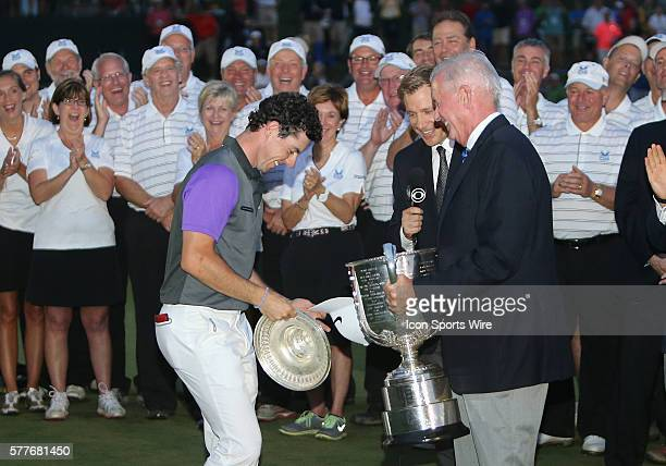 Rory McIlroy receives the Wanamaker Trophy from PGA President Ted Bishop after he wins the PGA Championship at Valhalla Golf Club in Louisville Ky
