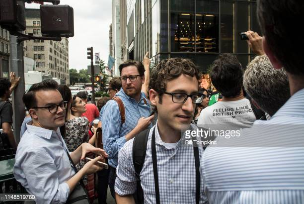MANDATORY CREDIT Bill Tompkins/Getty Images Spectators watch as a man climbs the glass exterior of the TRUMO Building on August 10 2016 in New York...