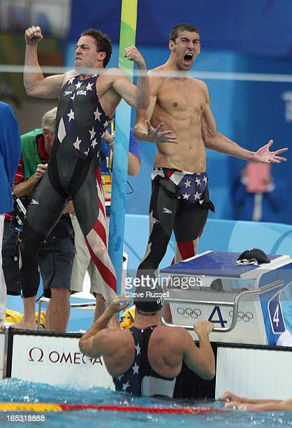 August 10 Michael Phelps right and the team's second swimmer celebrate their come from behind victory in the 4x100 m Freestyle relay by less than a...