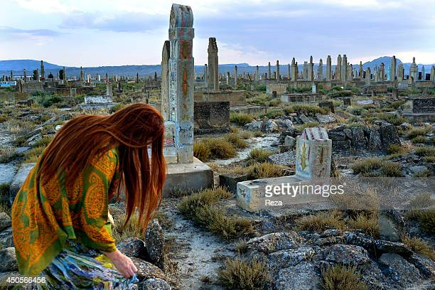 August 10 Sofi Hamid Cemetery, South of Baku, Azerbaijan. A Sufi, Azerbaijani painter visits the Sofi Hamid cemetery. The Azerbaijani people believe...