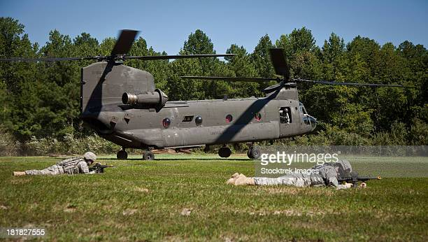 august 11, 2011 - u.s. soldiers provide security for a ch-47 chinook helicopter during an air assault mission at fort a.p. hill, virginia. - military attack stock pictures, royalty-free photos & images