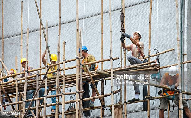 Features of Hong Kong Workers construct bamboo scaffolding at a building site in Hong Kong Bamboo is used mainly due its strength flexibility and low...
