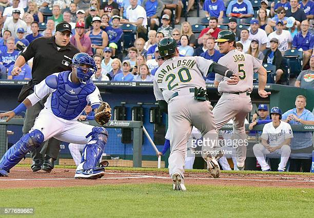 Kansas City Royals' catcher Salvador Perez gets ready to tag Oakland Athletics' third baseman Josh Donaldson out before he reaches the plate during a...