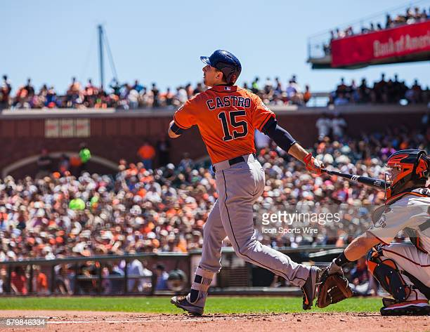 Houston Astros catcher Jason Castro at bat in the 3rd inning and following the trajectory of the ball before it is caught at the outfield wall during...