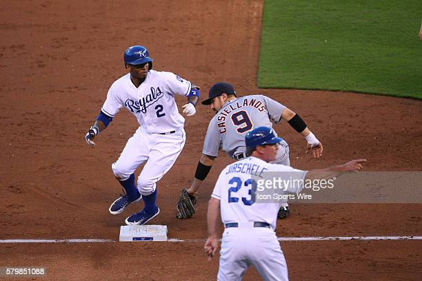 Kansas City Royals shortstop Alcides Escobar [6238] is set home by Kansas City Royals third base coach Mike Jirschele after Detroit Tigers third...