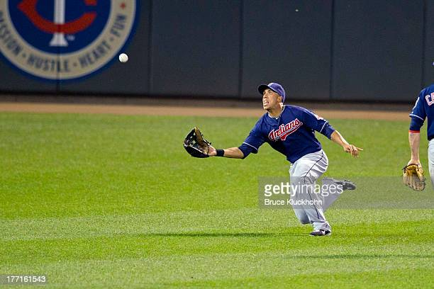 August 12: Michael Brantley of the Cleveland Indians fields a ball hit by the Minnesota Twins on August 12, 2013 at Target Field in Minneapolis,...