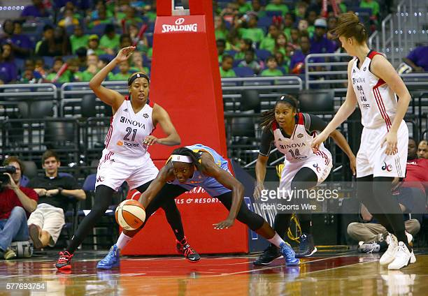 Chicago Sky center Sylvia Fowles reaches for a loose ball defended by Washington Mystics forward Tianna Hawkins Washington Mystics guard Tierra...