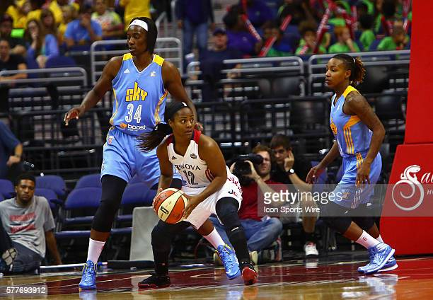 Washington Mystics guard Ivory Latta holds the ball in front of Chicago Sky center Sylvia Fowles during a WNBA game at Verizon Center in Washington...