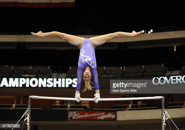 Olympic Gold Medalist Nastia Liukin of team WOGA practices on the uneven parallel bars before the start of the VISA Championships at the American...