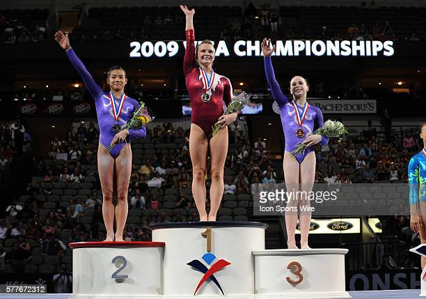 The 2009 all around champions Rebecca Bross in third place Ivana Hong in second place and in first place Bridget Sloan are honored after the VISA...