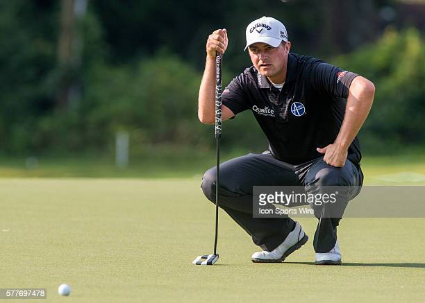 Brian Stuard analyzes the 9th green for his birdie attempt during the second round of the Wyndham Championship at Sedgefield Country Club in...