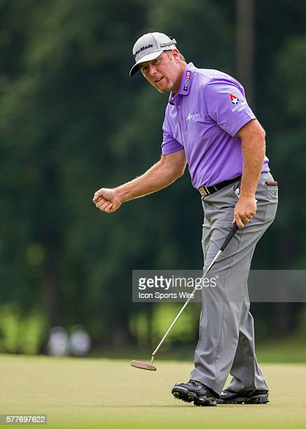 Points celebrates after sinking his putt for birdie on the 9th hole during the second round of the Wyndham Championship at Sedgefield Country Club in...