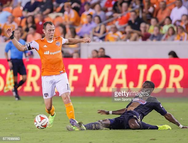 Philadelphia Union midfielder Maurice Edu slide tackles Houston Dynamo midfielder Brad Davis during the MLS Philadelphia Union vs Houston Dynamo...