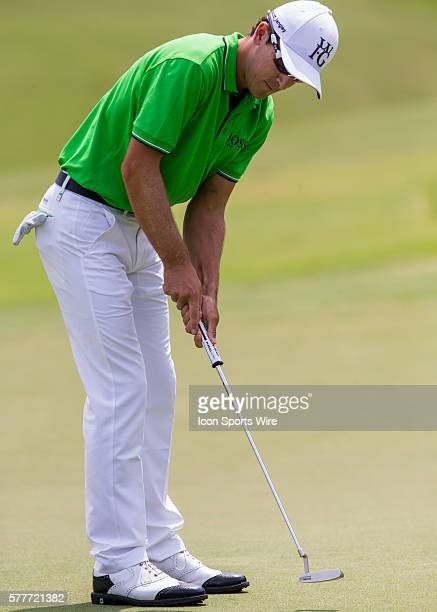 Scott Langley putts the ball on the 15th green during the second round of the Wyndham Championship at Sedgefield Country Club in Greensboro, NC.