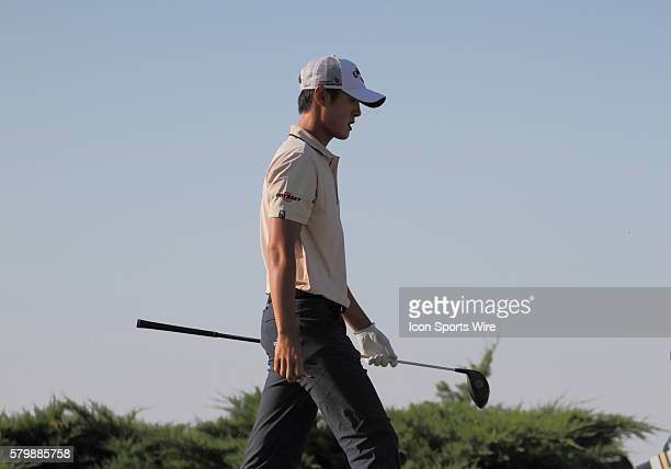 Danny Lee of New Zealand walks off the tee on number nine in continuing round two action that was suspended Friday due to weather Saturday morning of...