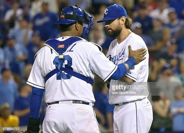 Kansas City Royals' catcher Salvador Perez talks to Kansas City relief pitcher Luke Hochevar during a Major League Baseball game between the Los...