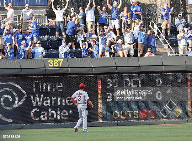 Los Angeles Kings' defenseman Brayden McNabb watches a home run ball by Kansas City Royals' catcher Salvador Perez go into the stands for a home run...
