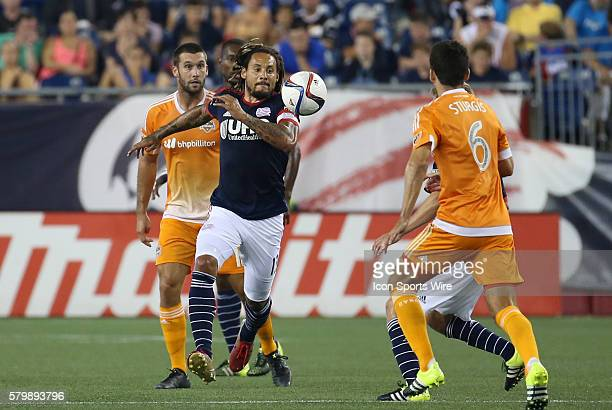 New England Revolution midfielder Jermaine Jones tracks the ball down with Houston Dynamo midfielder Nathan Sturgis in front. The New England...