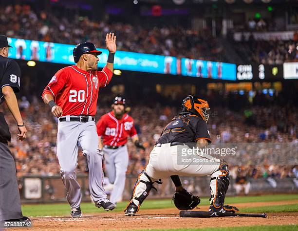 Washington Nationals shortstop Ian Desmond scores in the 6th inning as San Francisco Giants catcher Hector Sanchez awaits the ball during the MLB...