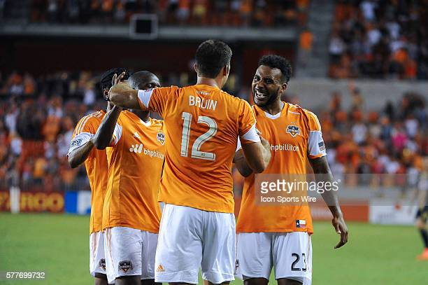 Houston Dynamo forward Will Bruin Houston Dynamo midfielder Giles Barnes and teammates celebrate a goal during the MLS eastern conference match...