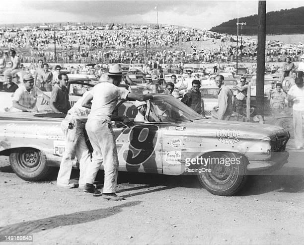Bob Welborn completes a pit stop on his way to winning the Western North Carolina 500 NASCAR Cup race at AshevilleWeaverville Speedway The event was...