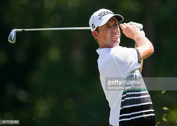 Webb Simpson hits an iron off the tee box during the third round of the Wyndham Championship at Sedgefield Country Club in Greensboro, NC.