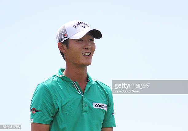 Danny Lee of New Zealand smiles as he walks off the tee on number nine during the final round of the PGA Championship at Whistling Straits in Kohler...