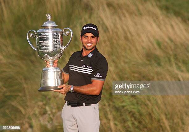 Jason Day of Australia hoists the Wanamaker Trophy after clinching the PGA Championship with a score of 20 under par after the final round of the PGA...