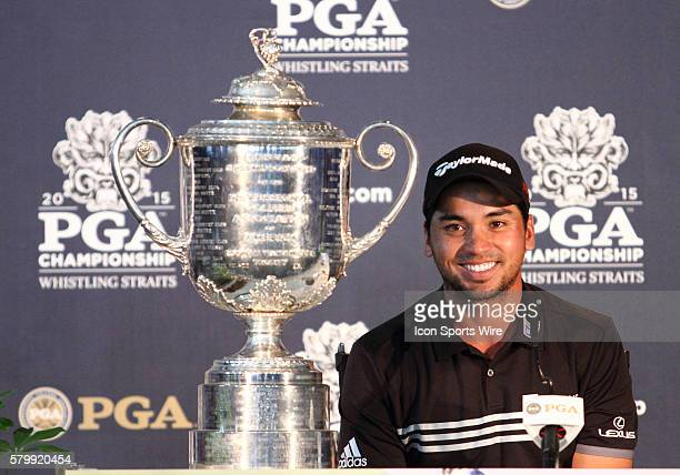 Jason Day shooting the only 20under par score in major championship history sits next to the Wanamaker Trophy after clinching the PGA Championship at...