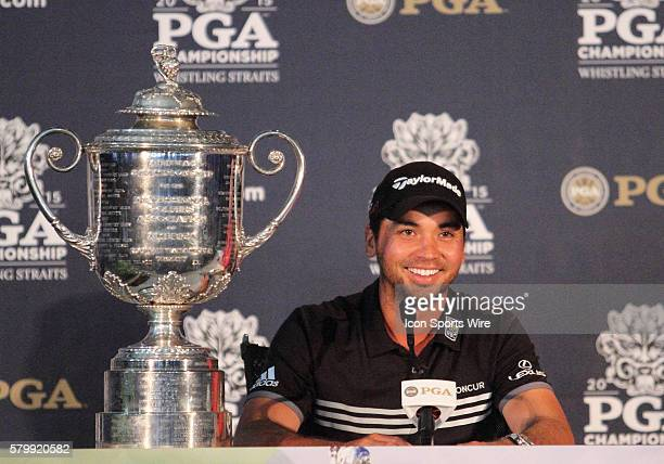 Jason Day, shooting the only 20-under par score in major championship history, sits next to the Wanamaker Trophy after clinching the PGA Championship...