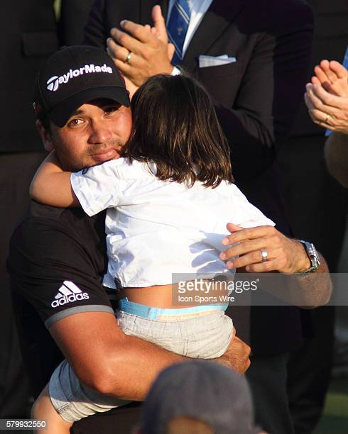 Jason Day, shooting the only 20-under par score in major championship history, hugs his son Dash after clinching the PGA Championship at Whistling...