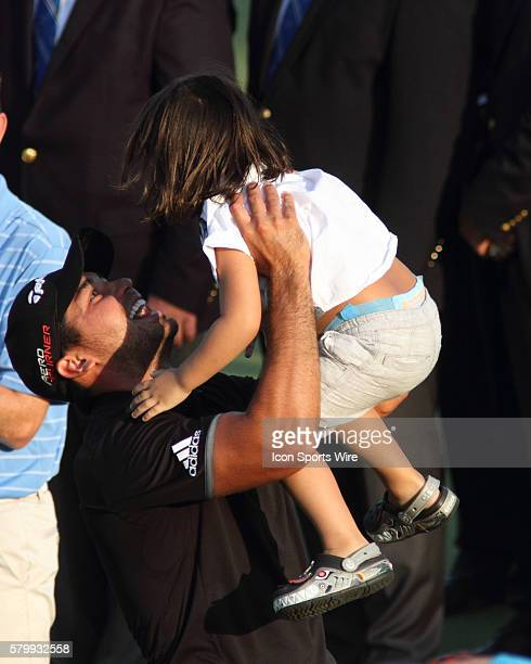 Jason Day shooting the only 20under par score in major championship history lifts his son Dash into the air after clinching the PGA Championship at...