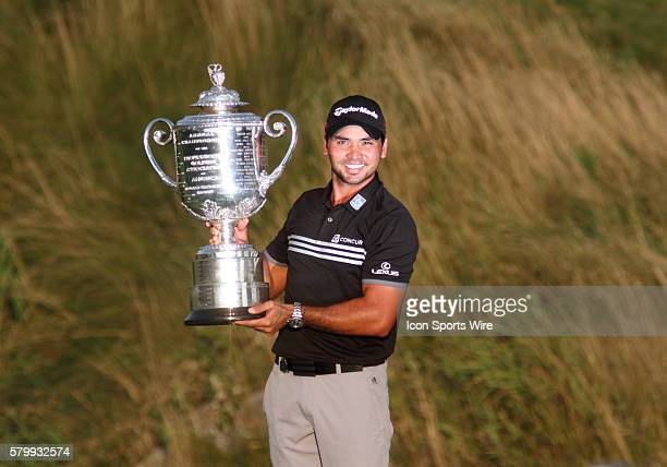 Jason Day shooting the only 20under par score in major championship history smiles and lifts the Wanamaker Trophy after clinching the PGA...