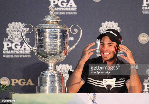Jason Day, shooting the only 20-under par score in major championship history, sits next to the Wanamaker Trophy and answers a question from the...