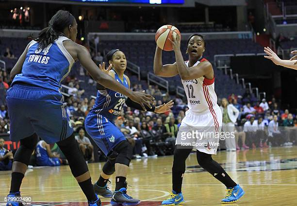 Minnesota Lynx center Sylvia Fowles and forward Maya Moore defend against Washington Mystics guard Ivory Latta during a WNBA game at Verizon Center...