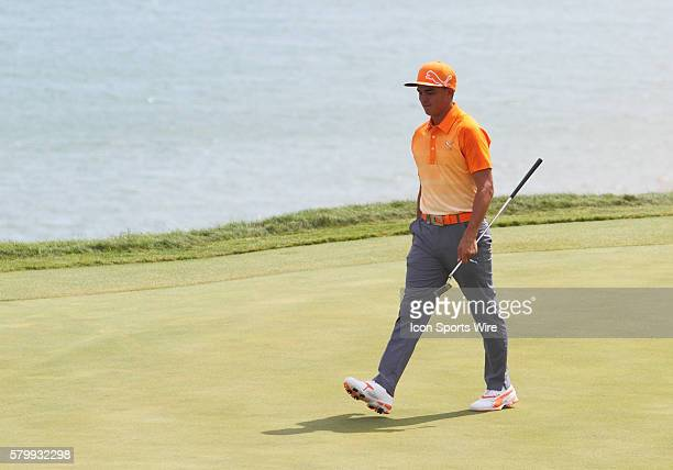 Rickie Fowler walks on to number twelve green after nearly scoring a hole in one during the final round of the PGA Championship at Whistling Straits...