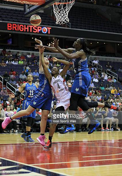 Washington Mystics guard Tayler Hill is trapped between Minnesota Lynx guard Tricia Liston and center Sylvia Fowles during a WNBA game at Verizon...