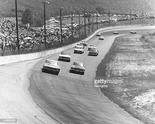 J D McDuffie takes his 1967 Buick to the outside of Wayne Smith's 1968 Chevrolet Chevelle as they try and stay ahead of the field during the running...