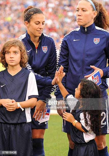 United States of America midfielder Carli Lloyd gets a high-five from a little girl during a match between USA and Costa Rica at Finley Stadium in...