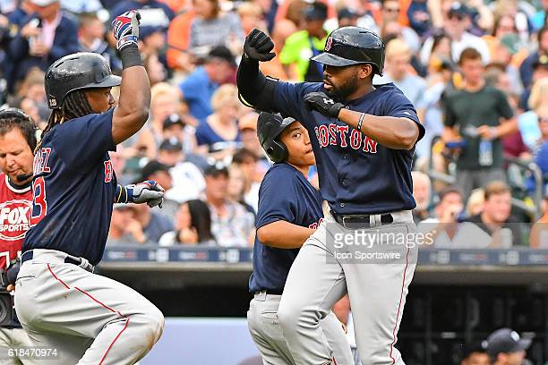 Boston Red Sox center fielder Jackie Bradley Jr. Celebrates his two run homer with Boston Red Sox first baseman Hanley Ramirez in the first inning...