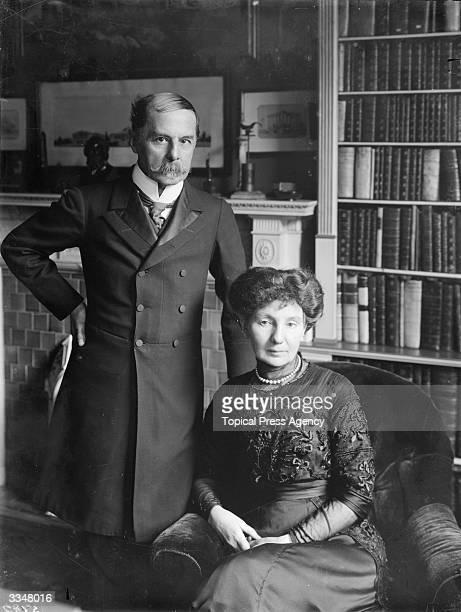 A middle aged Edwardian couple in their sitting room