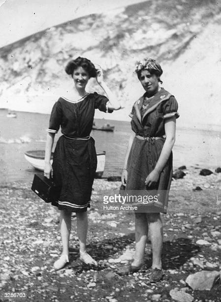Two bathing belles enjoy a sunny day on the beach at Lulworth Cove in Dorset maybe they have been using their Kodak camera