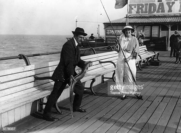 Mdlle Simone Mariex lands a conger eel on the pier at Folkestone during the International Beauty Show