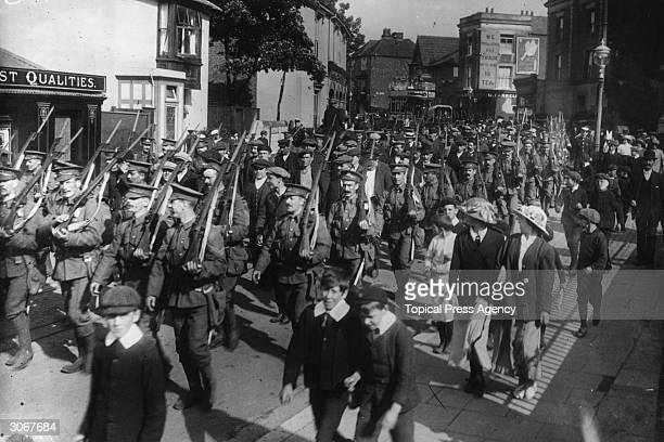 German prisoners of war are marched through Gosport Hampshire by British soldiers with drawn bayonets