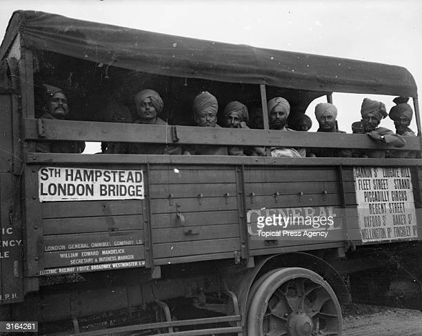 A Sikh tour party sightseeing on a lorry bus in postwar London