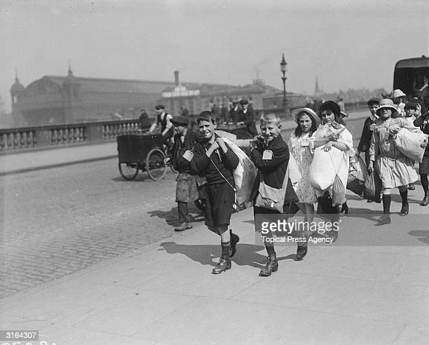 London children on their way to the train station on an outing organised by Children's Fresh Air Fund