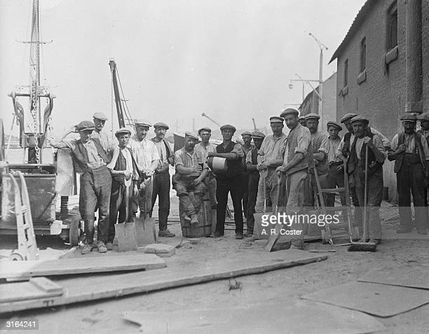 Workmen have a break from their work barrelling cement in Gravesend, Kent.